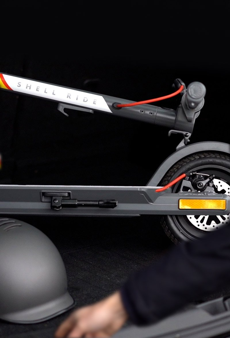 Photo Of Man Placing The SR-5S Scooter In A Trunk