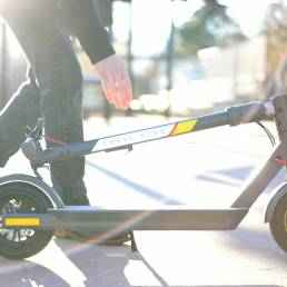 Photo Of Man Picking Up The SR-5S Scooter
